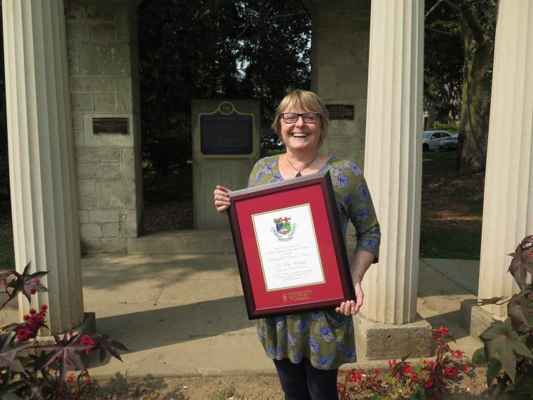 Tina with award